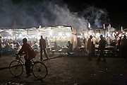 Smoke rises from the dazzling array of eateries bustling every night until late on Djemaa el-Fna square, the beating heart of the Marrakech medina, Morocco on November 16, 2007.