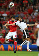 Ashley Williams of Wales (l) jumps for a header with Martin Harnik of Austria. Wales v Austria , FIFA World Cup qualifier , European group D match at the Cardiff city Stadium in Cardiff , South Wales on Saturday 2nd September 2017. pic by Andrew Orchard, Andrew Orchard sports photography