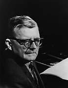 Dmitri Dmitriyevich Shostakovich (1906-1975), Russian composer of the Soviet period. Head-and-shoulders with Shostakovich turned halfway towards camera.