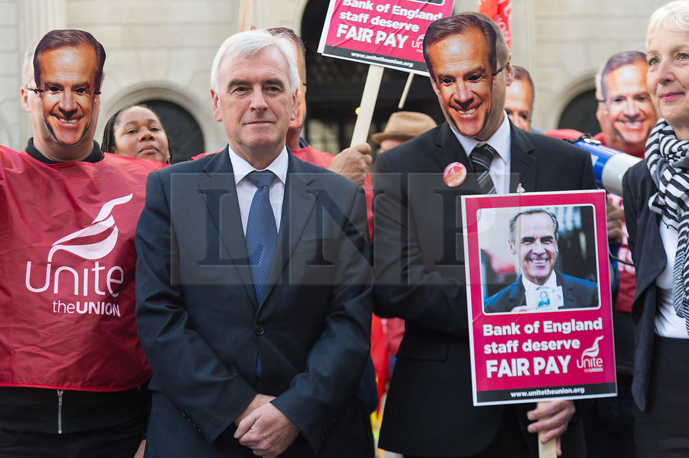 © Licensed to London News Pictures. 01/08/2017. London, UK. Labour shadow chancellor of the Exchequer, John McDonnell attends a demonstration in support of Unite trade union members outside the Bank of England   The strike is the first strike at the iconic bank in over 50 years due to being offered a below inflation pay offer. Photo credit: Ray Tang/LNP