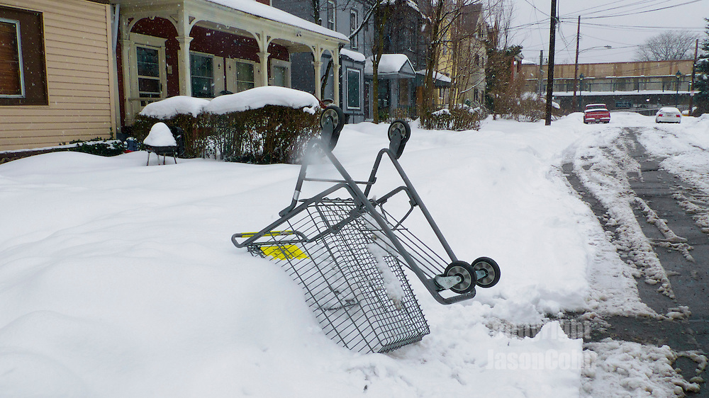 Parking spot reserved with shopping cart on Whitney Avenue in Wilkinsburg, PA.