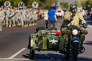 """11 NOVEMBER 2013 - PHOENIX, AZ: A men dressed as World War II veteran in the Phoenix Veterans Day Parade. The Phoenix Veterans Day Parade is one of the largest in the United States. Thousands of people line the 3.5 mile parade route and more than 85 units participate in the parade. The theme of this year's parade is """"saluting America's veterans.""""    PHOTO BY JACK KURTZ"""