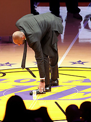 December 18, 2017 - Los Angeles, California, U.S - Former Los Angeles Laker Kobe Bryant puts the microphone down after addressing the fans  at a halftime ceremony, retiring both of his jersey s during a  NBA basketball game between the Los Angeles Lakers and  the Golden State Warriors, in Los Angeles, Monday,  December 18, 2017. (Credit Image: © Prensa Internacional via ZUMA Wire)