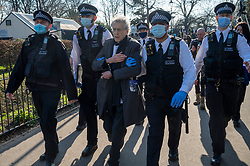 © Licensed to London News Pictures. 27/02/2021. London, UK. PIERS CORBYN is arrested by police officers at an anti-vaccination and anti-lockdown demonstration in Bishops Park area of Fulham, West London. The group  against the current tier regulations and anti-vaccination for the Covid-19 disease credit: Ray Tang/LNP