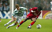Photo. Aidan Ellis.<br />Celtic v Lyon.<br />UEFA Champions League Group A Phase 1.<br />30/09/2003.<br />Celtic's Stilian Petrov and Lyon's Vikash Dhorasoo