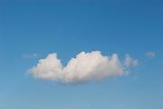 White fluffy clouds in a blue winter sky