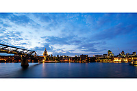 London night cityscape with St Paul's Cathedral, the Millennial Bridge and the City