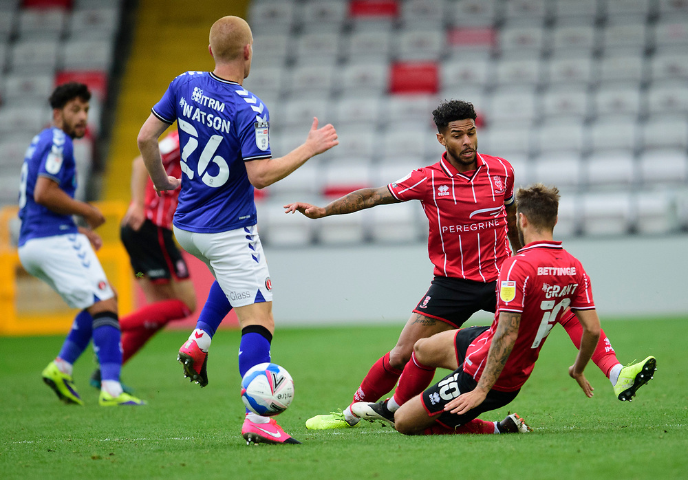 Charlton Athletic's Ben Watson battles with Lincoln City's Liam Bridcutt, centre, and Jorge Grant<br /> <br /> Photographer Andrew Vaughan/CameraSport<br /> <br /> The EFL Sky Bet League One - Lincoln City v Charlton Athletic - Sunday 27th September, 2020 - LNER Stadium - Lincoln<br /> <br /> World Copyright © 2020 CameraSport. All rights reserved. 43 Linden Ave. Countesthorpe. Leicester. England. LE8 5PG - Tel: +44 (0) 116 277 4147 - admin@camerasport.com - www.camerasport.com