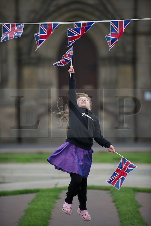 © Licensed to London News Pictures. 03/06/12.Middlesbrough, England...Tanza Brown, 7 leaps for joy during a party to celebrate the Queen's Diamond Jubilee in Middlesbrough town centre.. .The Royal Jubilee celebrations. Great Britain is celebrating the 60th  anniversary of the countries Monarch HRH Queen Elizabeth II accession to the throne this weekend Photo credit : Ian Forsyth/LNP