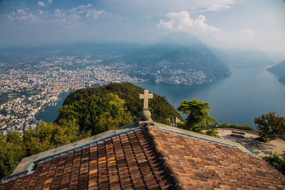 View of Lake Lugano from Monte San Salvatore with Lugano city in Switzerland. The most exceptional one is the 360° view visible from the rooftop of the church.