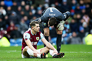 Burnley goalkeeper Nick Pope (1) checks on the injured Burnley defender James Tarkowski (5) during the Premier League match between Burnley and Bournemouth at Turf Moor, Burnley, England on 22 February 2020.