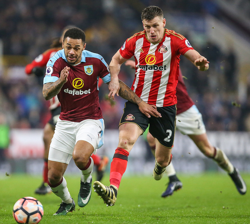 Burnley's Andre Gray shields the ball from Sunderland's Billy Jones<br /> <br /> Photographer Alex Dodd/CameraSport<br /> <br /> Emirates FA Cup Third Round Replay - Burnley v Sunderland - Tuesday 17th January 2017 - Turf Moor - Burnley<br />  <br /> World Copyright © 2017 CameraSport. All rights reserved. 43 Linden Ave. Countesthorpe. Leicester. England. LE8 5PG - Tel: +44 (0) 116 277 4147 - admin@camerasport.com - www.camerasport.com