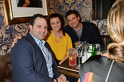 Left to right, ?, ? and EDWARD TAYLOR at the opening party of MODE nightclub, 12 Acklam Road, London on 4th April 2014.
