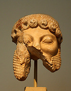 Fragments of a marble statue of Dionysus, found in the Attic deme of Ikaria.  The statue is colossal in scale and must have been a cult statue of the god.  The head was recently associated with the body.  It is uncertain whether the right hand with the kantharos belongs to the statue.  About 520-510 BC.