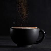 cinnamon craft latte on dark background, shot in studio