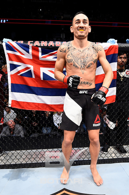 TORONTO, CANADA - DECEMBER 10:  Max Holloway stands in the Octagon prior to his interim UFC featherweight championship bout against Anthony Pettis during the UFC 206 event inside the Air Canada Centre on December 10, 2016 in Toronto, Ontario, Canada. (Photo by Jeff Bottari/Zuffa LLC/Zuffa LLC via Getty Images)