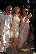 Damian Harris, Ella Harris and  Mrs. Robert Fox. Marriage of Emilia Fox to Jared Harris. St. Michael's and All Angels. Steeple. Nr. Wareham. Dorset. 16 July 2005. ONE TIME USE ONLY - DO NOT ARCHIVE  © Copyright Photograph by Dafydd Jones 66 Stockwell Park Rd. London SW9 0DA Tel 020 7733 0108 www.dafjones.com