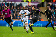 Jordan Ayew of Swansea City  and Christian Fuchs of Leicester City battle for the ball. Premier league match, Swansea city v Leicester city at the Liberty Stadium in Swansea, South Wales on Saturday 21st October 2017.<br /> pic by Aled Llywelyn, Andrew Orchard sports photography.
