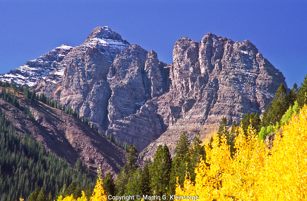 14,018 ft. Pyramid Peak during the autumn season.  Elk Mountains, Colorado.
