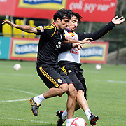 Galatasaray's players Mustafa SARP (L) and Mehmet TOPAL (R) during their training session at the Jupp Derwall training center, Tuesday, April 20, 2010. Photo by TURKPIX