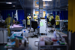 © Licensed to London News Pictures . 11/02/2021. Wythenshawe , UK . Clinicians provide care to patients on the ward . Covid positive patients are treated for the effects of Coronavirus in Wythenshawe's Intensive Care Unit . Photo credit : Joel Goodman/LNP