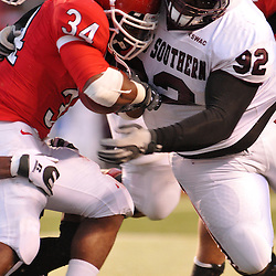 Oct 10, 2009; Piscataway, NJ, USA;  Texas Southern defensive lineman Fred Gaines hits Rutgers running back De'Antwan Williams (34) during second half NCAA college football action in Rutgers' 42-0 victory over Texas Southern at Rutgers Stadium.