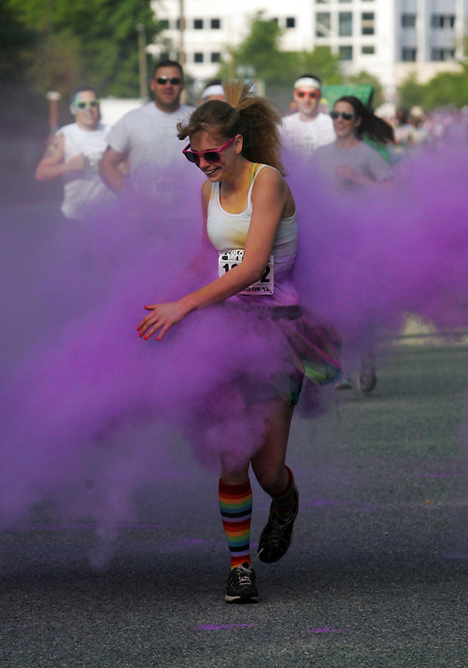 April 29, 2013; Newport News; VA; A runner goes through the 1k color station during the Newport News Color Me Rad 5k at the Newport News City Center. Mandatory Credit: Peter J. Casey
