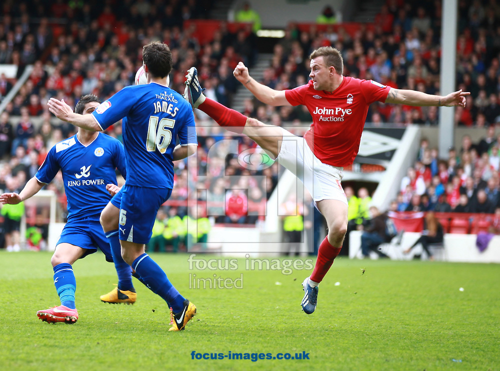 Picture by Tom Maddick/Focus Images Ltd 07854 863454.04/05/2013.Simon Cox of Nottingham Forest and Matty James of Leicester City during the npower Championship match at the City Ground, Nottingham.