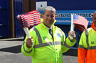A steward giving out American flags for Everton Goalkeeper Tim Howard's last game for the club. Barclays Premier League match, Everton v Norwich City at Goodison Park in Liverpool on Sunday 15th May 2016.<br /> pic by Chris Stading, Andrew Orchard sports photography.