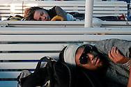 Greece: Tourist sleeping in a ferryboat. Grecia: Turisti dormono in traghetto