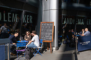 City workers drink outside a bar on Cannon Street which is a participating in the government's 'Eat Out to Help Out' scheme, an initiative for the food and drinks industry to help stimulate the wider economy during the Coronavirus pandemic, on 30th July 2020, in London, England.