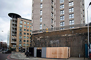 View of one of the most visible sites of shrapnel bomb damage from World War II in the East End, on Chamber Street wall in Tower Hamlets on 26th February 2020 in London, United Kingdom. Last year, Tower Hamlets council approved a planning application to demolish the wall to make way for a hotel extension. The East End Preservation Society are calling for the wall to be preserved.