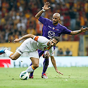 Galatasaray's Hamit Altintop (L) and ACF Fiorentina's during their friendly soccer match Galatasaray between ACF Fiorentina at the TT Arena in istanbul Turkey on Wednesday 08 August 2012. Photo by TURKPIX