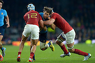 Michele Campagnaro of Italy charges into Alexandre Dumoulin of France and Bernard Le Roux of France. Rugby World Cup 2015 pool D match, France v Italy at Twickenham Stadium in London on Saturday 19th September 2015.<br /> pic by John Patrick Fletcher, Andrew Orchard sports photography.