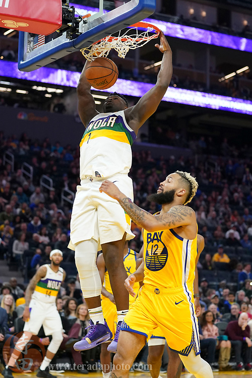 February 23, 2020; San Francisco, California, USA; New Orleans Pelicans forward Zion Williamson (1) dunks the basketball against Golden State Warriors guard Ky Bowman (12) during the fourth quarter at Chase Center.
