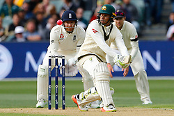 Australia's Usman Khawaja plays a shot as Jonny Bairstow looks on during day one of the Ashes Test match at the Adelaide Oval, Adelaide.