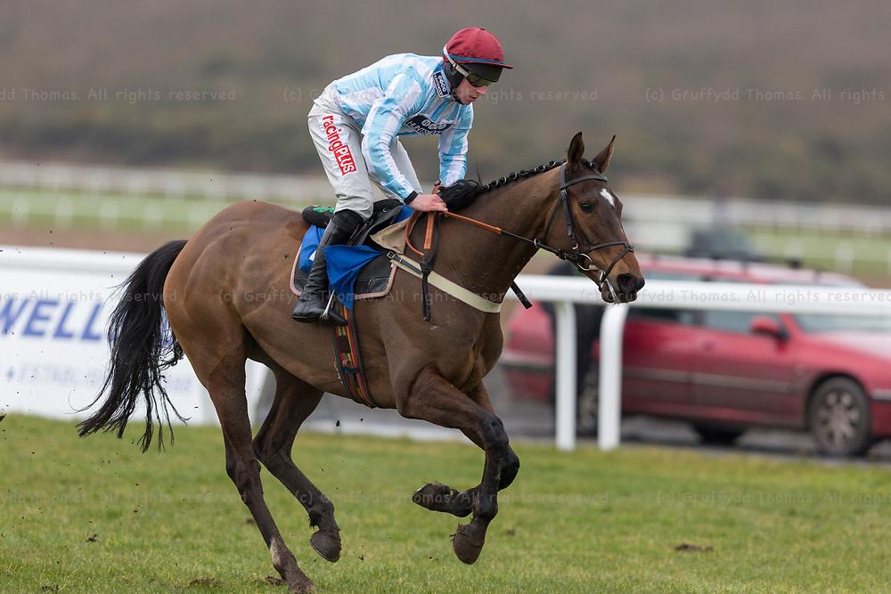 "Ffos Las Racecourse, Trimsaran, Wales, UK. Sunday 18 February 2018.  Scorpion Sid (jockey Gavin Sheehan) on the way to winning the British Stallion Studs EBF ""National Hunt"" Novices' Hurdle"