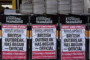 On the day that the UK Governments Chief Scientific Advisor, Sir Patrick Vallance said that the Coronavirus Covid-19 outbreak was now spreading person to person in the UK, the latest news headline from the capitals London Evening Standard newspaper is seen outside Embankment underground station, on 6th March 2020, in London, England.