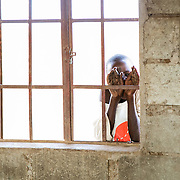 """We visited a school in Amboseli and had a chance to play with the children. This little boy was shy and peeked through the window instead.<br /> <br /> For all details about sizes, paper and pricing starting at $85, click """"Add to Cart"""" below."""