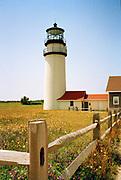 Highland Lighthouse with split rail fence on a sunny day, Wellfleet, Massachusetts