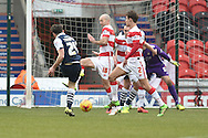 Ben Thompson of Millwall FC takes a shot at goal during the Sky Bet League 1 match between Doncaster Rovers and Millwall at the Keepmoat Stadium, Doncaster, England on 27 February 2016. Photo by Ian Lyall.