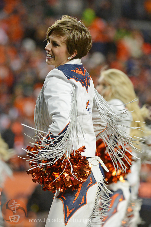 November 17, 2013; Denver, CO, USA; Denver Broncos cheerleader Sam performs during the third quarter against the Kansas City Chiefs at Sports Authority Field at Mile High. The Broncos defeated the Chiefs 27-17.