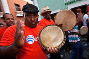 Musicians parade through the streets of Old San Juan during the Festival of San Sebastian in San Juan, Puerto Rico.