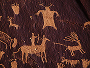 Historic Late Ute Indian Style petroglyphs including  horse with rider using bow and arrow to shoot at elk, Indian Creek, Newspaper Rock State Park and Bears Ears National Monument, Utah.