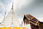 23 JUNE 2011 - CHIANG MAI, THAILAND: A stupa behind the teak viharn at Wat Pan Tao in Chiang Mai, Thailand. Wat Pan Tao is famous for its teak wood viharn that was once a royal residence.  Photo by Jack Kurtz