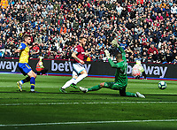 Football - 2018 / 2019 Premier League - West Ham United vs. Southampton<br /> <br /> Marko Arnautovic of West ham scores his first half goal past goalkeeper. Fraser Forster, at The London Stadium.<br /> <br /> COLORSPORT/ANDREW COWIE