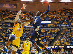 Dec 8, 2018; Morgantown, WV, USA; Pittsburgh Panthers guard Sidy N'Dir (11) dunks the ball during the first half against the West Virginia Mountaineers at WVU Coliseum. Mandatory Credit: Ben Queen-USA TODAY Sports