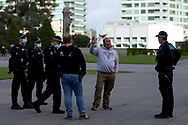 MELBOURNE, VIC - SEPTEMBER 05: A man is seen talking with police before the Anti-Lockdown Protest on September 05, 2020 in Sydney, Australia. Stage 4 restrictions are in place from 6pm on Sunday 2 August for metropolitan Melbourne. This includes a curfew from 8pm to 5am every evening. During this time people are only allowed to leave their house for work, and essential health, care or safety reasons. (Photo by Dave Hewison/Speed Media)