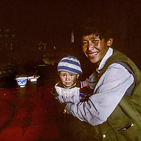 CHINA, TIBET.  Father & daughter at home in Pe village, near Tsangpo River Gorge.