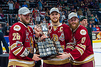 REGINA, SK - MAY 27:  Olivier Galipeau #26, Jeffrey Truchon-Viel #25 and Adam Holwell #13 of Acadie-Bathurst Titan accept the Memorial Cup trophy at centre ice after the win against the Regina Pats at Brandt Centre - Evraz Place on May 27, 2018 in Regina, Canada. (Photo by Marissa Baecker/CHL Images)